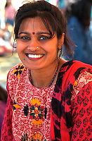 Indian woman age 28 in ethnic clothing at Asian American Festival.     St Paul Minnesota USA
