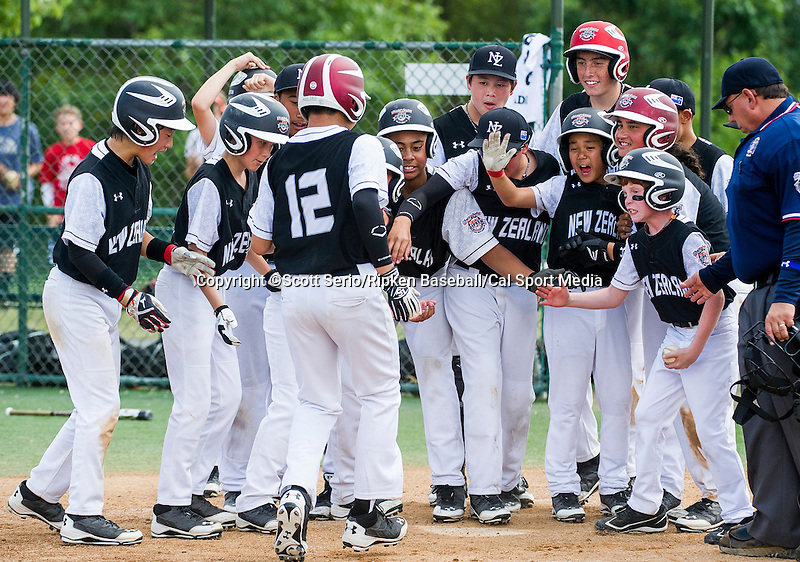 August 13, 2014: Scenes from Australia's 11-10 victory against New Zealand during the Cal Ripken 12u 70-foot World Series at the Ripken Experience powered by Under Armour in Aberdeen, Maryland on August 13, 2014. Scott Serio/Ripken Baseball/CSM