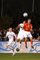 Wake Forest Demon Deacons defender Julian Valentin (4) and Virginia Tech Hokies defender Georg Zehender (3) go for a header during an NCAA College Cup semi-final match at SAS Stadium in Cary, NC on December 14, 2007. Wake Forest defeated Virginia Tech 2-0.