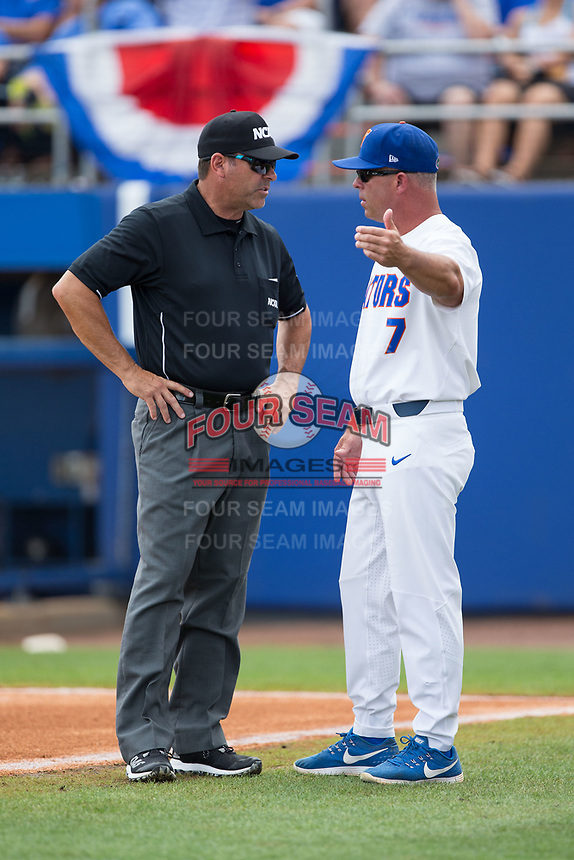Florida Gators head coach Kevin O'Sullivan (7) has a discussion with first base umpire Perry Costello during the game against the Wake Forest Demon Deacons in Game One of the Gainesville Super Regional of the 2017 College World Series at Alfred McKethan Stadium at Perry Field on June 10, 2017 in Gainesville, Florida.  The Gators defeated the Demon Deacons 2-1 in 11 innings.  (Brian Westerholt/Four Seam Images)
