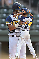 Right fielder Aaron Maher (27) of Eest Tennessee State hugs 10-year-old Gehrig Skole, son of head coach Tony Skole, after hitting a home run in a game against Samford at the Southern Conference Baseball Championship on Saturday, May 27, 2017, at Fluor Field at the West End in Greenville, South Carolina. ETSU won, 16-6. (Tom Priddy/Four Seam Images)