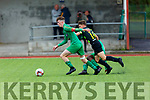 1  Kerrys captain James Rusk attempts to go forward under pressure from Shamrock Rovers Shane Nealon in the SSE U17 game in Mounthawk Park on Sunday.