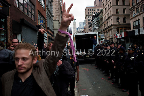 New York, New York<br /> November 15, 2011<br /> <br /> After the police clear Zuccotti Park many of the evicted &quot;Occupy Wall Street&quot; protesters, reconvened in Foley Square and march Juan Pablo Duarte Square at Canal and 6th Ave and final back to Zuccotti Park to wait a court order to reenter the park.