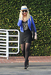 March 30th 2012 ..Christina Aguilera shopping at Fred Segal in Los Angeles with her brother . She was wearing no bra with her nipple showing & maybe pregnant again with little baby bump. Wearing diamond sunglasses red lipstick black leather purse handbag skull skeleton shirt blue jacket sweater  with zebra painted nails ..AbilityFilms@yahoo.com.805-427-3519.www.AbilityFilms.com.