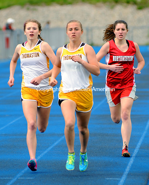WINSTED,  CT, 24 APRIL  2012-042412JS05--Thomaston's Sabrina Olsen, center, won the 1600 Meter while Northwestern's Cameron Chaplen, left and Northwestern's Kathleen Wysocki, finished second and third respectively during their meet with Wamogo Tuesday at Northwest Regional High School in Winsted. .Jim Shannon Republican-American