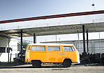 an abandoned VW bus at a deserted gas station in page arizona captures the swaying ethos of the american west