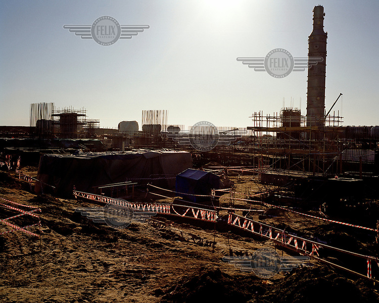 Construction of the Bolashak Onshore Processing Plant. The facility, which processes oil from the Kashagan field, is run by Agip KCO on behalf of a consortium which consists of Shell, Exxon Mobil, Total, ConocoPhillips, Eni, KazMunayGas and Inpex. The discovery of Kashagan's commercial reserve of around 13 billion barrels of oil in 2000 was one of the largest finds in decades.