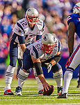 12 October 2014: New England Patriots quarterback Tom Brady (12) calls out signals before receiving a snap from center Ryan Wendell (62) during a game against the Buffalo Bills at Ralph Wilson Stadium in Orchard Park, NY. The Patriots defeated the Bills 37-22 to move into first place in the AFC Eastern Division. Mandatory Credit: Ed Wolfstein Photo *** RAW (NEF) Image File Available ***
