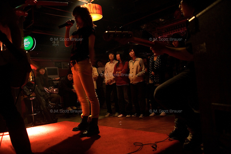 Ruan Ruan, singer for the Chinese punk band Overdose, performs in a concert in Castle Bar in Nanjing, Jiangsu, China.