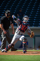 Scottsdale Scorpions catcher Mitch Garver (16) throws down to first as umpire Tom Woodring looks on during an Arizona Fall League game against the Mesa Solar Sox on October 19, 2015 at Sloan Park in Mesa, Arizona.  Scottsdale defeated Mesa 10-6.  (Mike Janes/Four Seam Images)