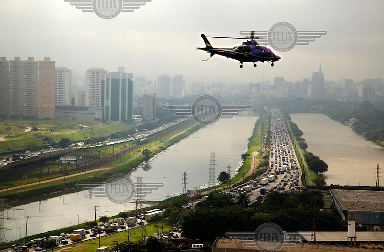 It takes only seven minutes to fly from Alphaville, an up-market residential area on the outskirts of Sao Paulo, to Avenida Paulista, the financial heart of the city. By car the same distance could take up to two hours during rush hour..