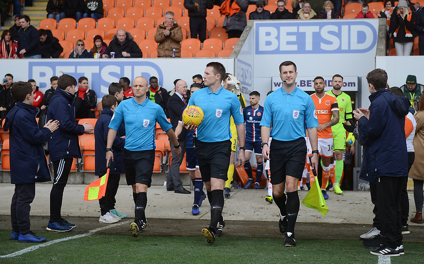 Referee Thomas Bramall leads the teams out<br /> <br /> Photographer Kevin Barnes/CameraSport<br /> <br /> The EFL Sky Bet League One - Blackpool v Walsall - Saturday 9th February 2019 - Bloomfield Road - Blackpool<br /> <br /> World Copyright © 2019 CameraSport. All rights reserved. 43 Linden Ave. Countesthorpe. Leicester. England. LE8 5PG - Tel: +44 (0) 116 277 4147 - admin@camerasport.com - www.camerasport.com