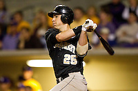 Matt Conway #25 of the Wake Forest Demon Deacons follows through on his swing against the LSU Tigers to extend his consecutive game hitting streak to 19 at Alex Box Stadium on February 18, 2011 in Baton Rouge, Louisiana.  The Tigers defeated the Demon Deacons 15-4.  Photo by Brian Westerholt / Four Seam Images