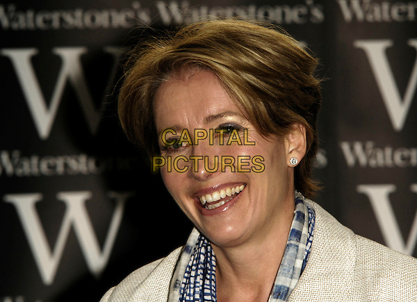 """EMMA THOMPSON .Book singing for """"Nanny McPhee And The Big Bang"""", Waterstone's Picadilly, London, England..March 6th 2010.headshot portrait grey gray blue scarf checked check beige cream smiling .CAP/CJ.©Chris Joseph/Capital Pictures."""