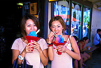 Visitors to Oahu's north shore stop for a local  taste treat, Shave Ice.