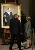 United States President George W. Bush (L) and First Lady Laura Bush pause in front of a portrait of Chief Justice William Rehnquist Sept. 6, 2005 in the Great Hall of the Supreme Court in Washington, DC. Rehnquist's casket will lie in repose at the court until the next morning and he will be buried in a private ceremony at Arlington Cemetery that afternoon. <br /> Credit: Chip Somodevilla / Pool via CNP