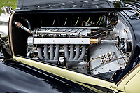 BNPS.co.uk (01202 558833)<br /> Pic: Bonhams/BNPS<br /> <br /> The 2.3l supercharged twin-cam 8-cylinder engine. <br /> <br /> A classic car bought by a British motoring enthusiast for £750 before it was nearly written off by a drunk driver has sold for £3.8m.<br />  <br /> The 1932 Bugatti Type 55 roadster belonged to the late Geoffrey St John for over 50 years until his death last February.<br /> <br /> In 1994 he was badly injured when the motor was ploughed into by a drunk driver in France.<br /> <br /> Luckily the car - then valued at about £1m - could be salvaged and repaired.