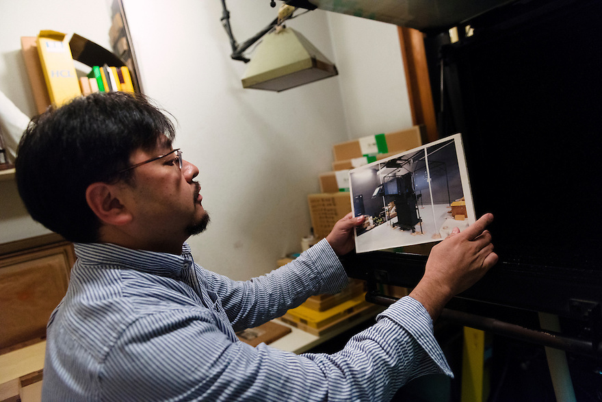 Benrido photographer Katsuhiko Honjo with a photograph of the atelier's film camera. Benrido collotype atelier, Kyoto, Japan, October 9, 2015. The Benrido collotype atelier in Kyoto was founded in 1887 and is the only full-scale commercial collotype atelier in the world. Collotype is a historic photographic printing process that makes use of plates coated in gelatine. It produces prints of unrivalled quality.