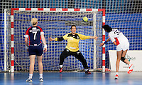 22 OCT 2011 - LONDON, GBR - British goalkeeper Jane Mayes (#66 - yellow and black) attempts to save a free throw during the Women's 2012 European Handball Championship qualification match against Russia at the National Sports Centre at Crystal Palace.(PHOTO (C) NIGEL FARROW)