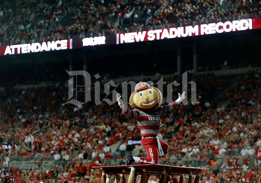 Brutus reacts to the announcement of a new attendance record at Ohio Stadium during the fourth quarter of Saturday's NCAA Division I football game at Ohio Stadium in Columbus on September 27, 2014. (Columbus Dispatch photo by Jonathan Quilter)