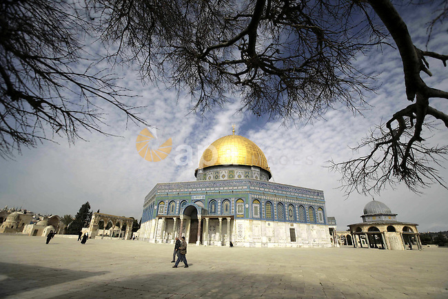 Palestinians walk in front of the Dome of the Rock on the compound known to Muslims as al-Haram al-Sharif, and to Jews as Temple Mount in Jerusalem's Old City February 2, 2010 Photo by Mohamar Awad