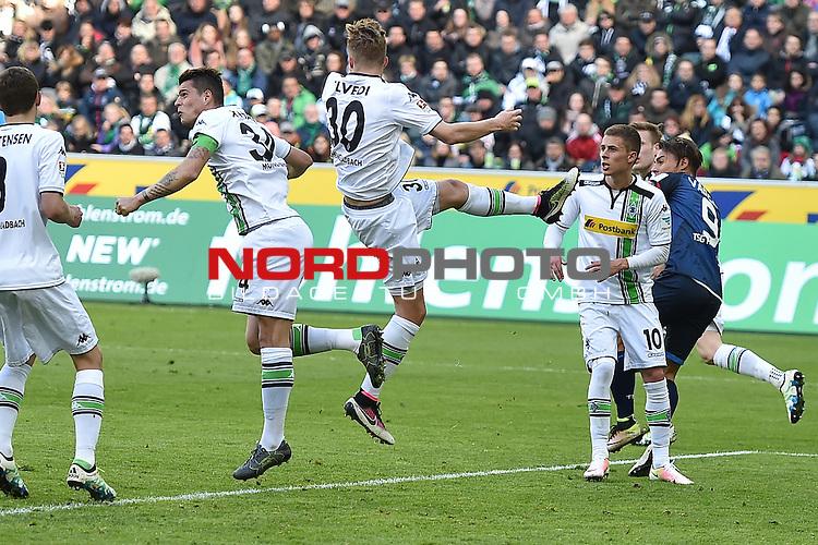 24.04.2016, Borussia-Park, Moenchengladbach, GER, 1.FBL,  Borussia Moenchengladbach vs TSG 1899 Hoffenheim <br /> im Bild / picture shows: <br /> schwierige Situation im Strafraum Nico Elvedi (Borussia M&ouml;nchengladbach #30) und Thorgan Hazard (Borussia M&ouml;nchengladbach #10) hinten Eduardo J&egrave;sus Vargas (1899 Hoffenheim #9)<br /> <br /> <br /> <br /> Foto &copy; nordphoto / meuter
