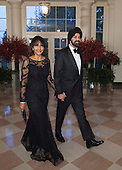 Ajay Banga, President and CEO, Mastercard and Mrs. Ritu Banga arrive at the State Dinner for China's President President Xi and Madame Peng Liyuan at the White House in Washington, DC for an official State Visit Friday, September 25, 2015. Credit: Chris Kleponis / CNP