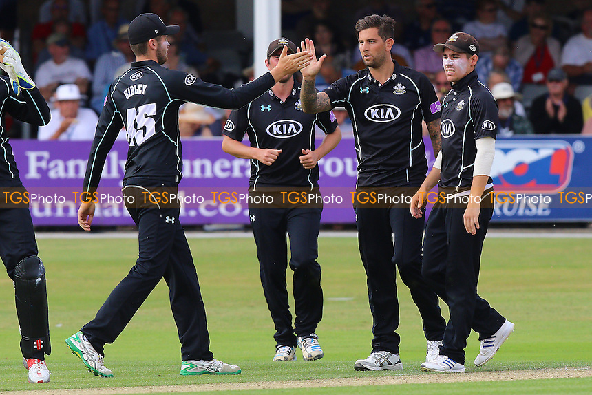 Jade Dernbach of Surrey (2nd R) is congratulated by his team mates after taking the wicket of Jesse Ryder during Essex Eagles vs Surrey, Royal London One-Day Cup Cricket at the Essex County Ground on 24th July 2016