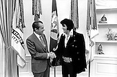 Washington, DC - December 21, 1970 -- United States  President Richard M. Nixon welcomes entertainer Elvis Presley to the Oval Office in the White house in Washington, D.C. on December 21, 1970..Credit: White House / CNP