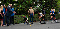 United States president Donald J. Trump cheers on runners participating in the White House Sports and Fitness Day at the White House in Washington, DC, May 30, 2018. <br /> CAP/MPI/RS<br /> &copy;RS/MPI/Capital Pictures