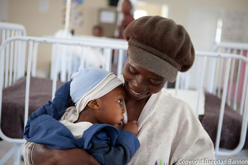 """Muchoneta Chiparawasha has brought her baby Tadiwanashe, 18 months old, to the therapeutic feeding clinic in MSF's Overspill clinic in Epworth, an urban settlement adjacent to the capital Harare of Zimbabwe. """"My son was refusing any other food than breast milk and he was beginning to develop kwashiorkor. My family advised me to come here and now he is getting better."""".With 14.3 per cent prevalence rate (UNAIDS 2009), Zimbabwe is one of the countries worst affected by the worldwide HIV/AIDS epidemic. Since 2007, MSF has been running an HIV/AIDS project in Epworth. In August 2011, MSF had 12,864 patients under care in both of its clinics there."""