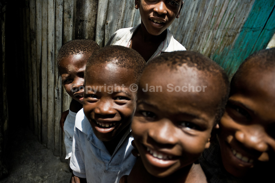 Haitian children play joyfully in the slum of Cité Soleil, Port-au-Prince, Haiti, 24 July 2008. Cité Soleil is considered one of the worst slums in the Americas, most of its 300.000 residents live in extreme poverty. Children and single mothers predominate in the population. Social and living conditions in the slum are a human tragedy. There is no running water, no sewers and no electricity. Public services virtually do not exist - there are no stores, no hospitals or schools, no urban infrastructure. In spite of this fact, a rent must be payed even in all shacks made from rusty metal sheets. Infectious diseases are widely spread as garbage disposal does not exist in Cité Soleil. Violence is common, armed gangs operate throughout the slum.
