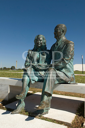 Brasilia, Brazil. Lifesize statue of the late president Juscelino Kubitschek, who made Brasilia into a reality, with his wife Sara, seated on a bench outside the Kubitschek Memorial.