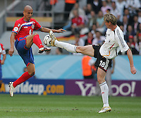 JUNE 9, 2006: Munich, Germany: Costa Rican midfielder (6) Danny Fonseca collides with German midfielder (18) Tim Borowski during the World Cup Finals in Munich, Germany.