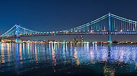 Benjamin Franklin Bridge, reflecting lights on the Delaware River Philadelphia PA,