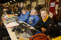 Wednesday, February 13, 2013. Volunteers (L to R) Barb Abercrombie, Hannah Kelliher, Andi Malard and Leslie Washburn do the neccessary paperwork during the musher's food drop day at Airland Transport in Anchorage.