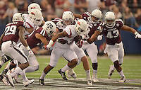 STAFF PHOTO BEN GOFF  @NWABenGoff -- 09/27/14 Texas A&M defenders Howard Matthews, left, and Jordan Mastrogiovanni tackle Arkansas running back Korliss Marshall during the first quarter of the Southwest Classic at AT&T Stadium in Arlington, Texas on Saturday September 27, 2014.