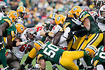 Green Bay Packers defense gang tackles Tampa Bay Buccaneers running back LaGarrette Blount (27) during a Week 11 NFL football game on November 20, 2011 in Green Bay, Wisconsin. The Packers won 35-26. (AP Photo/David Stluka)