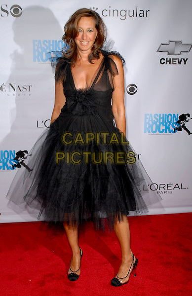 DONNA KAREN.Conde Nast Media Group's Third Annual Fashion Rocks Concert at Radio City Music Hall, New York, NY, USA,.7 September 2006..Full length puffy skirt designer black dress karan.Ref: ADM/PH.www.capitalpictures.com.sales@capitalpictures.com.©Paul Hawthorne/AdMedia/Capital Pictures. *** Local Caption ***