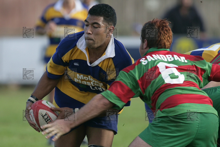 J. Maka about to be taken by D. Olsen. Counties Manukau Premier Club Rugby, Waiuku vs Patumahoe played at Rugby Park, Waiuku on the 8th of April 2006. Waiuku won 18 - 15