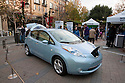 Display of fully electric Nissan Leaf car. Nissan Leaf Zero Emission Tour promotional event for the Nissan Leaf electric car that is scheduled to be released in Fall 2010. Car specs from Nissan: 5 person capacity, 90 MPH top speed, lithium-ion battery, 100 mile average range per charge. Santana Row, San Jose, California, USA, 12/5/09