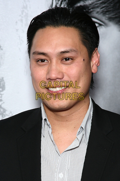 "JON CHU (director).Special Screening of ""Justin Bieber: Never Say Never"" at the Regal 42nd Street E-Walk Cinemas, New York, USA, 2nd February 2011..portrait headshot smiling  black jacket grey gray shirt .CAP/LNC/TOM.©LNC/Capital Pictures."