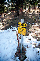 A sign marking the border between Pinewoods Springs and the Arapahoe-Roosevelt National Forest in Pinewood Springs, Colorado, Wednesday, February 1, 2012. National Forests in Colorado could, under rule making now going on in the Obama administration, have much reduced protections from development than the rest of the nation under the so-called roadless rules, proposed in the Clinton administration, and recently vindicated by a federal appeals panel..Photo by Matt Nager