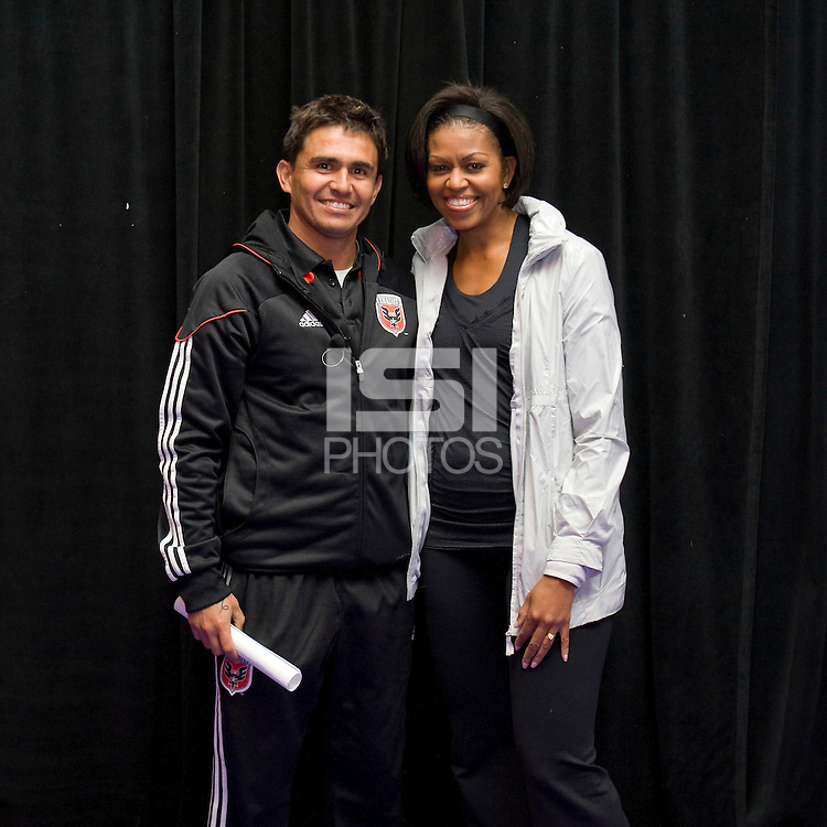 First Lady Michelle Obama stands with DC United player Jaime Moreno during a US Soccer Foundation clinic held at City Center in Washington, DC.