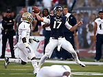 Nevada quarterback Cody Fajardo scrambles away from UC Davis defender Dre Allen during the first half of a college football game in Reno, Nev., on Saturday, Sept. 7, 2013. (AP Photo/Cathleen Allison)
