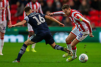 11th January 2020; Bet365 Stadium, Stoke, Staffordshire, England; English Championship Football, Stoke City versus Milwall FC; Jayson Molumby of Millwall tackles Nick Powell of Stoke City - Strictly Editorial Use Only. No use with unauthorized audio, video, data, fixture lists, club/league logos or 'live' services. Online in-match use limited to 120 images, no video emulation. No use in betting, games or single club/league/player publications