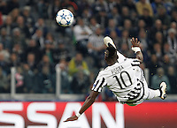 Calcio, Champions League: Gruppo D - Juventus vs Siviglia. Torino, Juventus Stadium, 30 settembre 2015.  <br /> Juventus&rsquo; Paul Pogba performs a bicycle kick during the Group D Champions League football match between Juventus and Sevilla at Turin's Juventus Stadium, 30 September 2015.<br /> UPDATE IMAGES PRESS/Isabella Bonotto