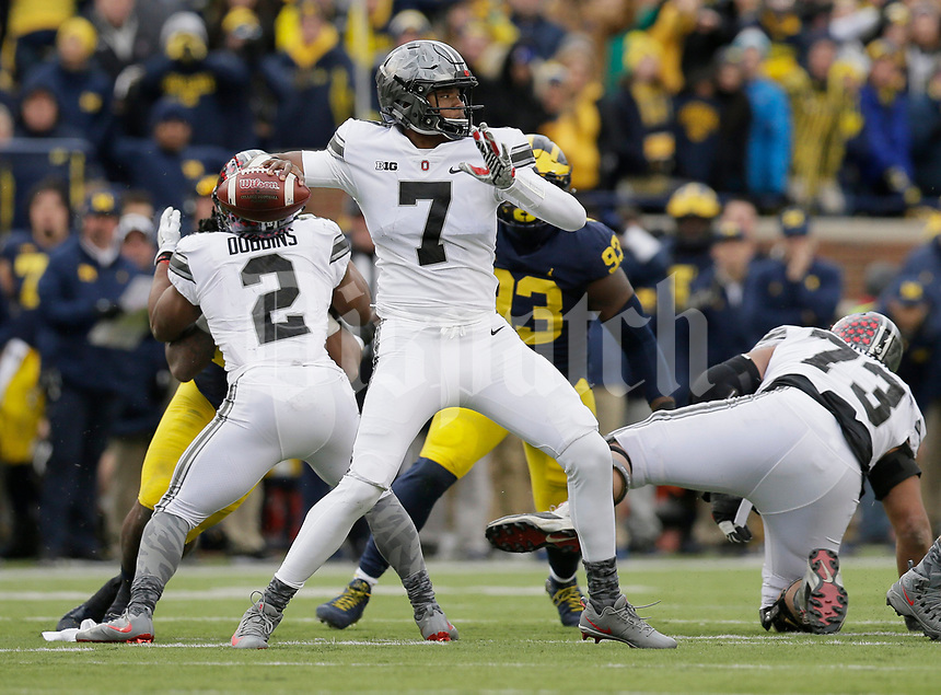 Ohio State Buckeyes quarterback Dwayne Haskins (7) drops back to pass during the third quarter of the NCAA football game against the Michigan Wolverines at Michigan Stadium in Ann Arbor on Nov. 25, 2017. Ohio State won 31-0. [Adam Cairns/Dispatch]