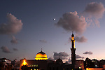 The moon is seen above a mosque in Gaza city on Sept. 13,2010 . Photo by Mohammed Asad