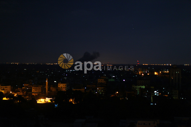 Smoke rises from a building after an Israeli air strike in Gaza city on August 10, 2014. Palestinian and Israeli negotiators on Sunday said they had accepted an Egyptian proposal for a new 72-hour truce with Israel, clearing the way for a possible resumption of talks on a long-term cease-fire arrangement in the Gaza Strip. Photo by Mohammed Othman